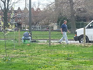 Technicians worked on maintaining lights along streets in Hunting Park on Tuesday, April 16.
