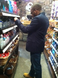 Local shopper, Kyree Smith, browses through product at Condom Kingdom.