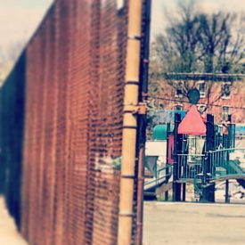 Children play on a local playground in Powelton Village. Nancy Tkacs explained parents are hindered in letting their children play outside in high crime areas.