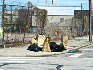 Volunteers placed piles of trash they collected from the different blocks along the streets for disposal.