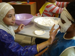 Children from the Art of Growing Up program participate in mask-masking.