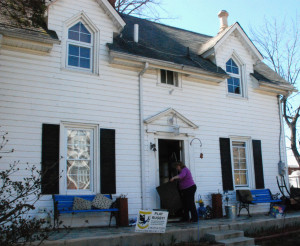 Helen Gill swept off her porch at her home at 4200 Decatur St.