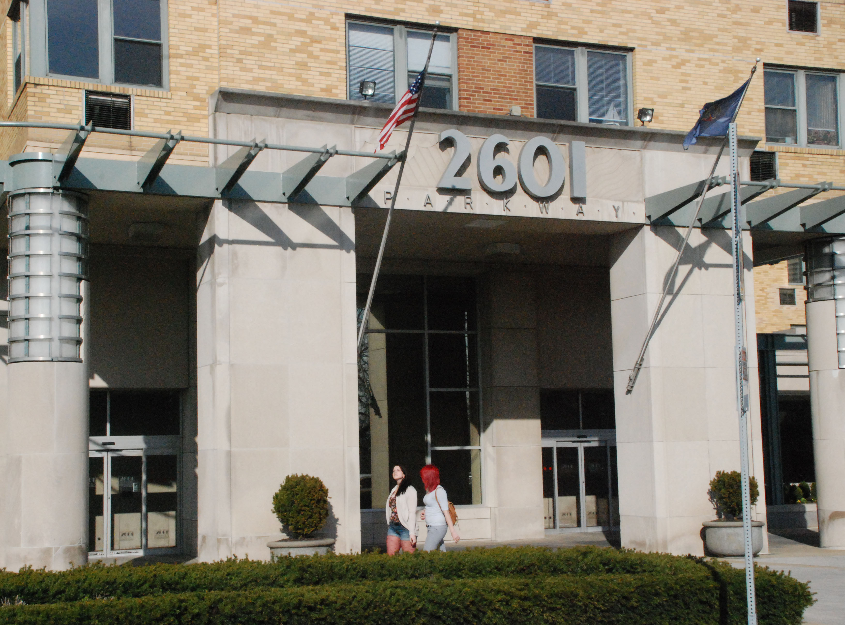 Two woman walked in front of 2601 Pennsylvania Ave. where Helen and Sean Gill own a condo.