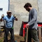 Zach Eggleston and Nic Esposito built a new wooden fence to replace an old chain link fence.