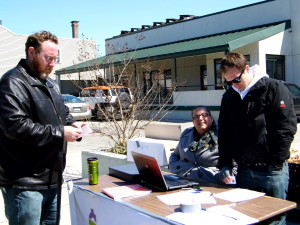 Equal Dollars staff explained the program to the community at 2nd and Thompson streets Saturday afternoon.