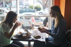 Mackenzie Peet and Jenna Bartelt ate sandwiches at Rybread.