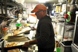 Rybread employee Dennis Pollock prepared chicken for sandwiches.