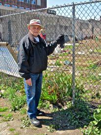 Rodriquez stands outside of the community garden on his block, La Finquita.