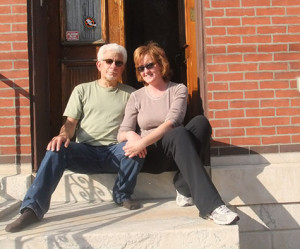 James DiMartino and his wife Mary sit outside of their home which sits across the street from townhomes at the former site of the  Rosa Food Products warehouse.