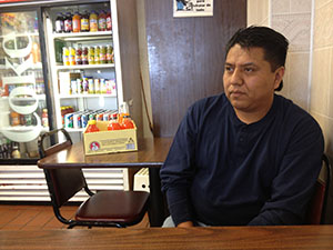 Ignacio Flores sat in the bakery that he works in.