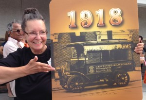 """Wawa employee, """"Jane"""" presented the 1918 showcard--the year Wawa transitioned to motorized delivery vehicles."""