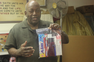 Pastor Matthew Gallashaw II held a care package of basic toiletries.