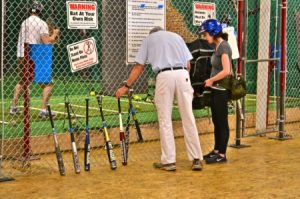 A selections of bats for hitters leaned against the middle cage.