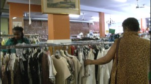 Customers sift through racks of affordable clothing for anything that catches their eye.