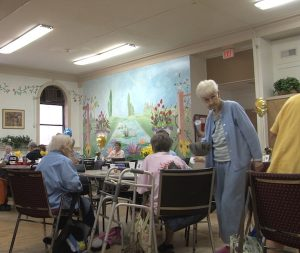 On the first floor of Lutheran Settlement House a group of senior citizens are enjoying a game of Bingo.