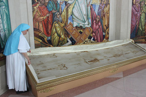 Sister Evenhia revealed the Shroud of Turine, which is kept under a large sheet unless a mass is taking place.