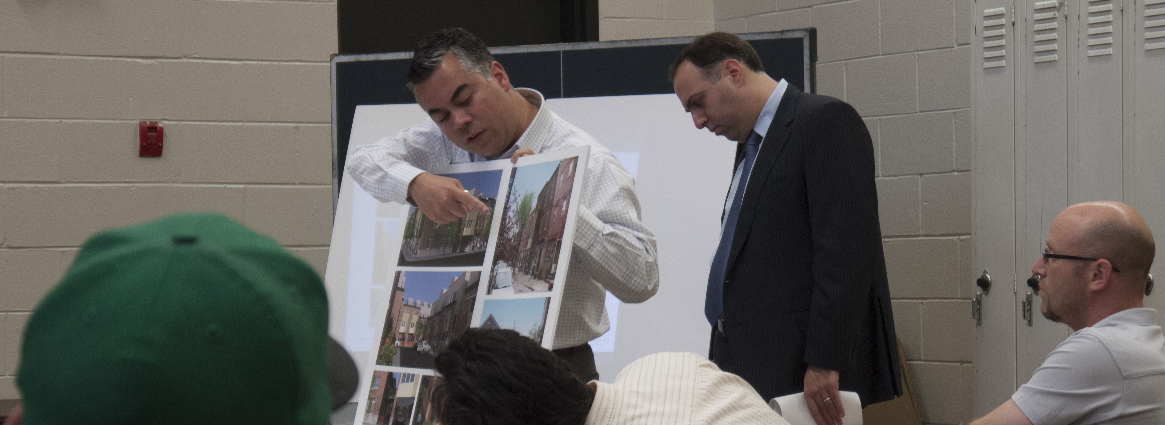 Representatives from U.S. Construction Incorporated and JKR Partners show construction plans for new townhouses in Bella Vista