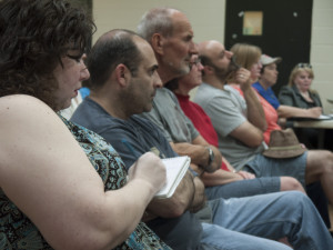 Local resident Dawn Fallik takes notes on neighborhood meeting concerning new townhouses to be constructed in Bella Vista