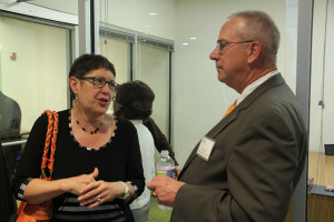 Al Thorell (right), Chairman of the Board, talks with a member of the community.