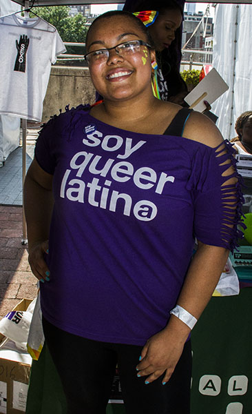 Karla Diaz, Youth Education Coordinator at Galei works the organizations booth at Philly Pride.