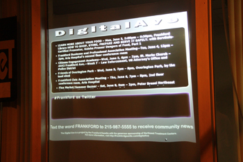 "The Frankford Gazette's ""Digital Ave"" display projects neighborhood news on a storefront."