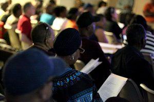 A Mantua resident looks at the community meeting agenda.