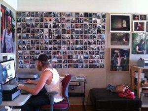Jeffrey Stockbridge edits photographs at his studio in the Vox Populi building on N. 11 th Street.