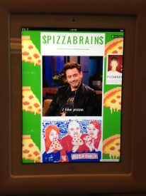 iPads are fixated into the walls of Pizza Brain and display sample of its online content.