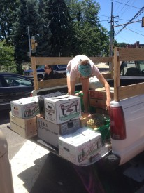 Lauren Marsella unloaded the truck filled with produce