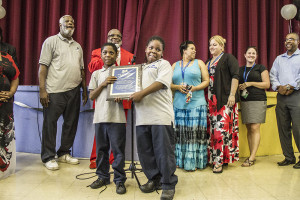 Two students show off an award for academic achievement during the school's celebration for high rankings.