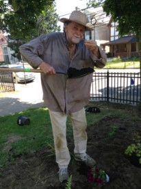 "Tom Grabe, local gardener, tests the soil ""the best way."""