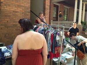 Shoppers look through yard sale.