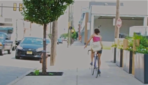 A cyclist road on the sidewalk which, though common, is illegal for riders over the age of 12.