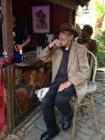 Joseph Tiberino, patriarch of the Tiberino family, enjoy a jazz performance in his backyard.