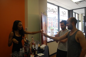 Traci White was served free wine and spirit samples to customers such as Ross Ennis (left) and Chris Edelman.