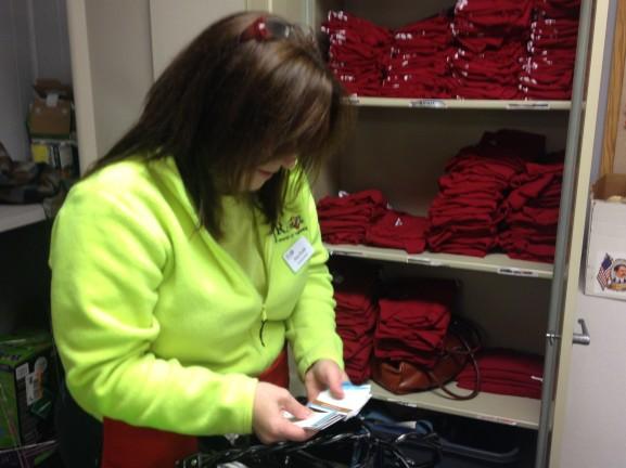 JRA Executive Director Amy Krulik organizes the storage room in the warehouse.
