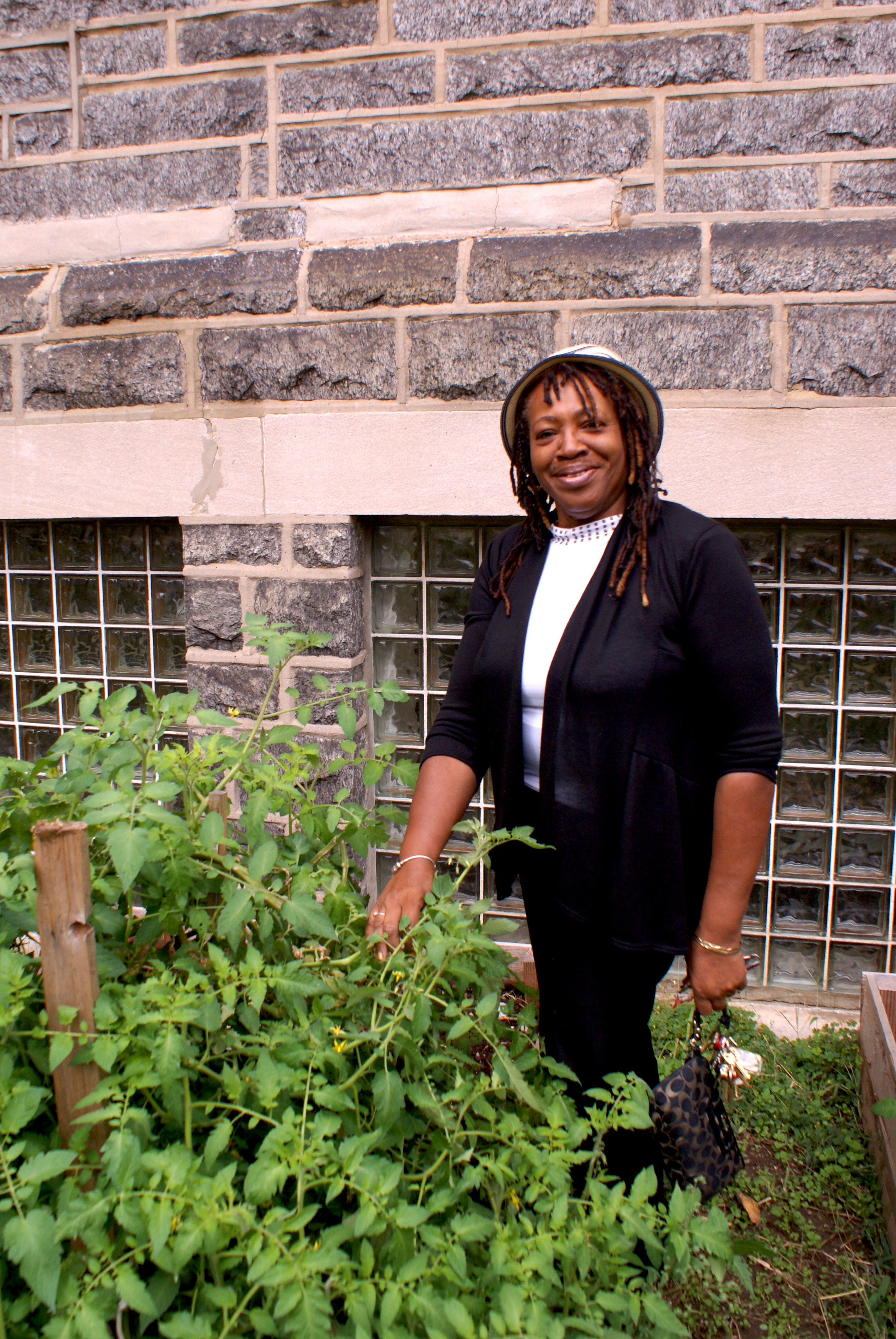 Rev. Margaret Powell stands in the Solid Rock United Methodist community garden, which, in conjunction with contributions from Philabundance and SHARE, eases the pain of neighborhood hunger.