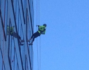 One volunteer rappels down the side of the One Logan Square building.