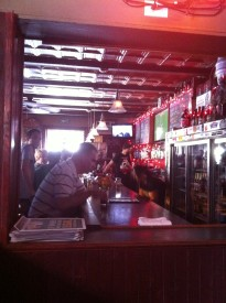 The inside of the Brew House offers seating at the bar or tables by the kitchen.