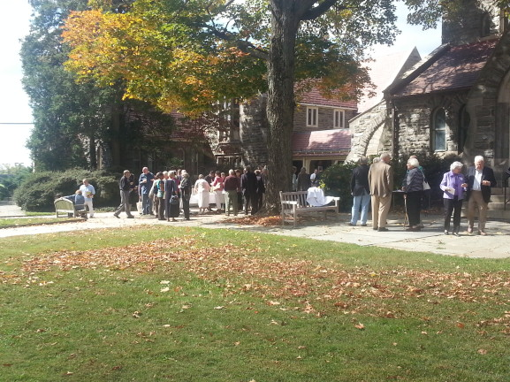 Congregant members gather outside after services for a quick bite.