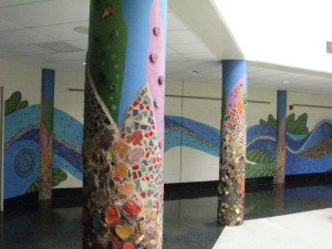 Mural painted on walls in Baldi Middle School by members of the ArtsRising initiative.