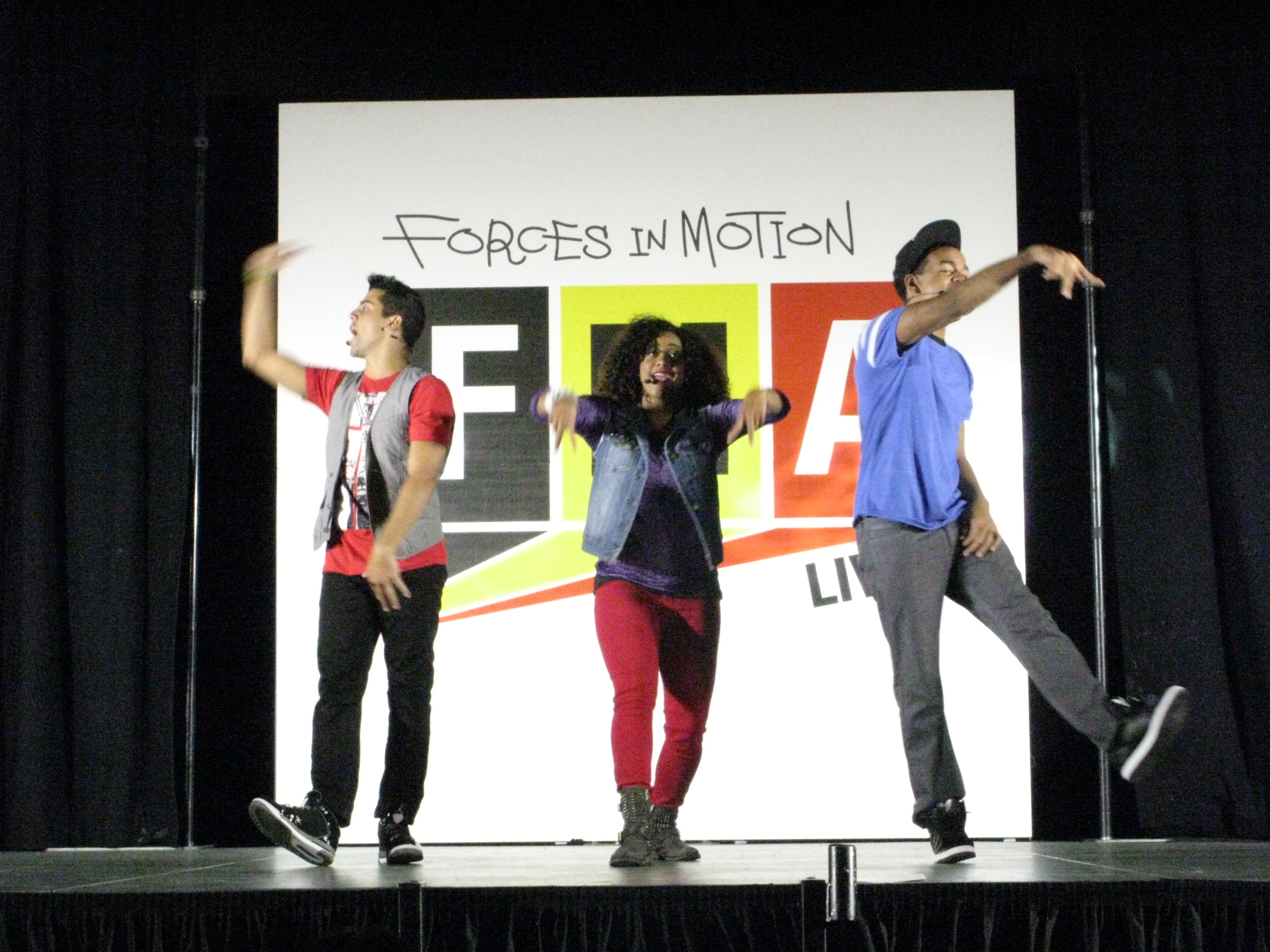 FMA Live dancers perform in front of Baldi Middle School students and teachers.