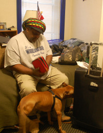 Wallace Presley, sergeant major of PVCH, looks after Millie, a rescued pit bull and the house pet.