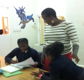 Students engage in various activities in Mighty Writers.