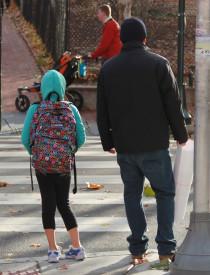 Children walk to Penn Alexander School on a Monday morning.