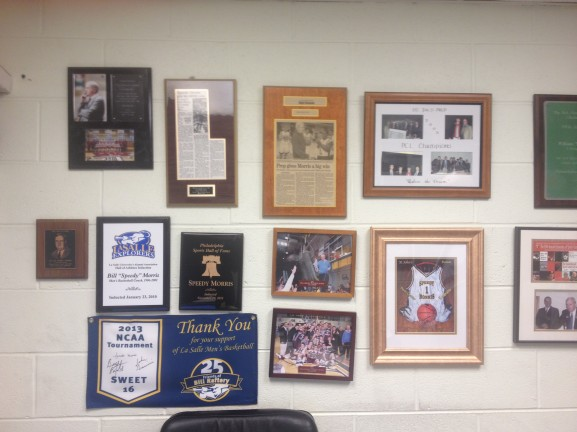 Morris has a number of achievements and well-wishes from over the years hanging in his office.