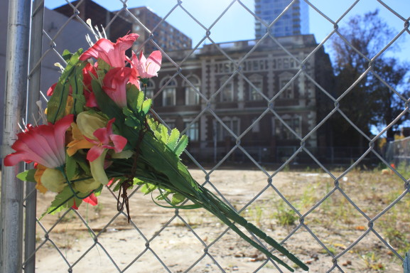 A bouquet of flowers overlooks the site of the former Salvation Army thrift store.