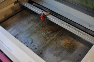 A machine that uses lazers to engrave into plastic, metal or wood.