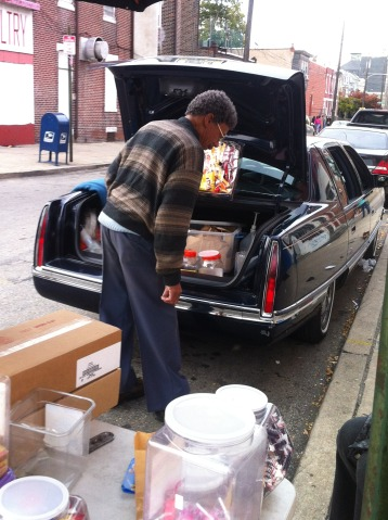Harold Cliett looks for a specific item in his Cadillac.
