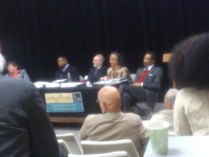 The panelists listen to an audience member's question.